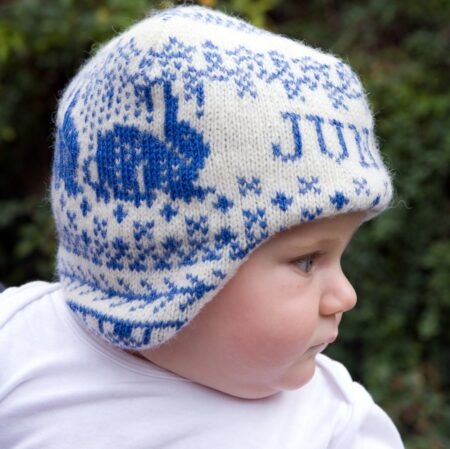 Baby wearing the Personalised Animals hat in mid-blue