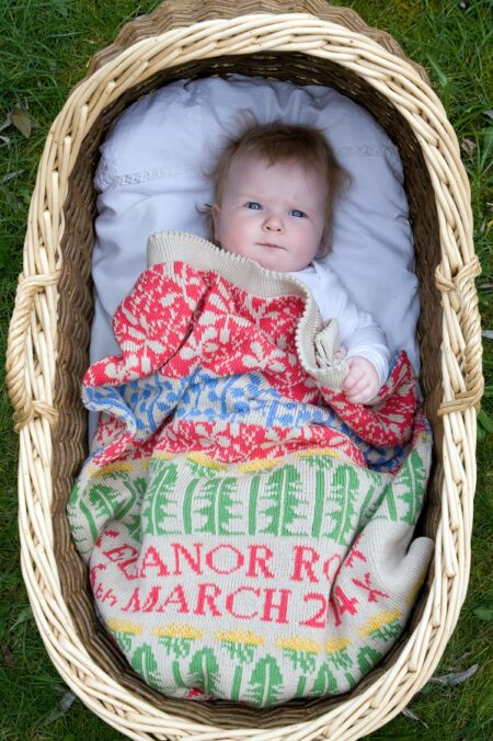 Craxton personalised baby blanket in MEADOW, with baby in basket