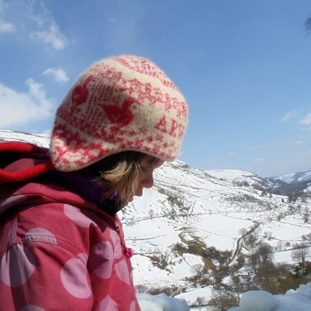 Warm and cosy knitted hat outdoors in the winter snow!