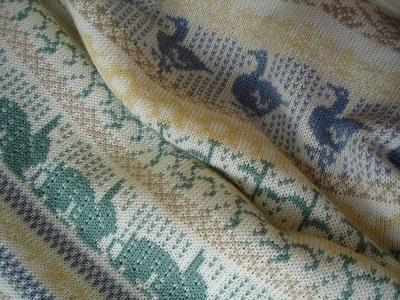 Knitted Animals & Flowers baby blanket in merino wool - detail