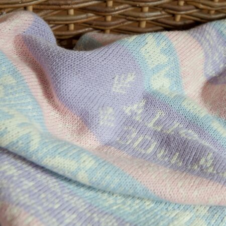 Cashmere baby blanket in moses basket